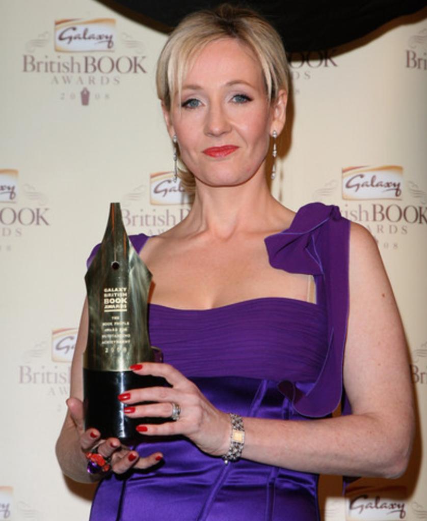 Author JK Rowling holding an award